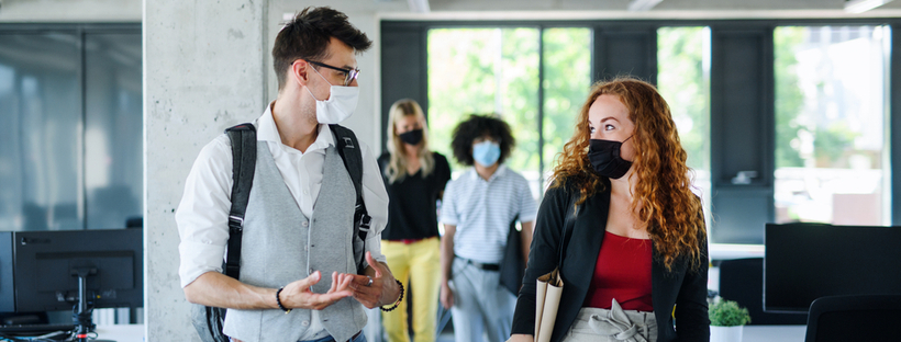Young people wearing masks at work