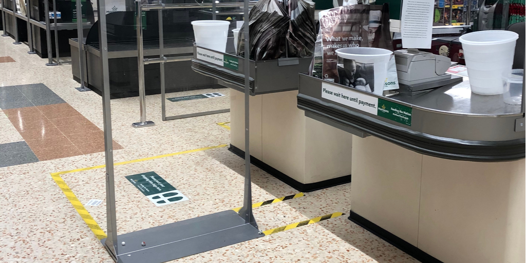Social distancing floor stickers at store checkout area
