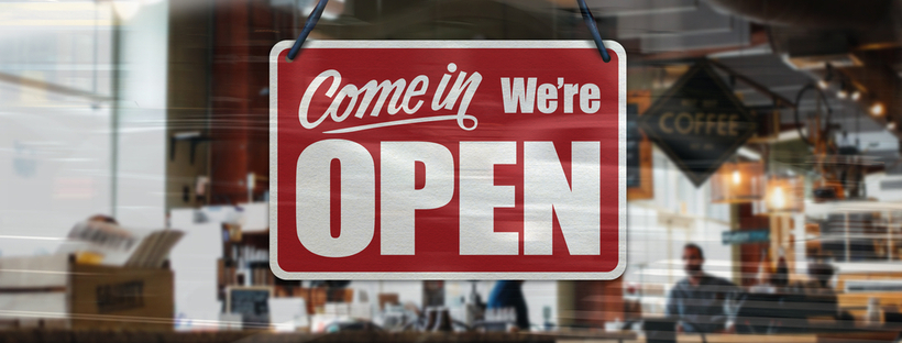 'Open' sign on store window